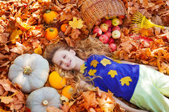 Free Portrait Of Beautiful Girl On Leaves With Pumpkins Royalty Free Stock Image - 61879356
