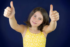 Portrait Of Beautiful Little Girl Showing Ok Sign Royalty Free Stock Images