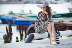 Free Portrait Of Beautiful Woman In Hat On The Pier Stock Photos - 79971643