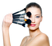Portrait Of Beautiful Woman With Make-up Brushes Stock Images