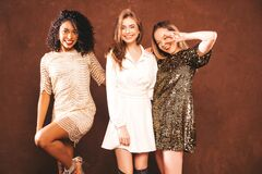 Portrait Of Beautiful Women Posing In Studio Stock Photos