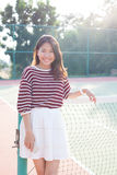 Portrait Of Beautiful Young Asian Woman Wearing White Clothes Skirt In Tennis Course With Happy Face Royalty Free Stock Photography