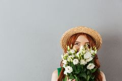 Portrait Of Beautiful Young Woman With Ginger Hair Wearing Straw Stock Images