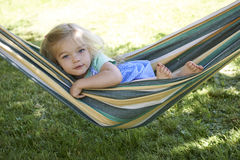 Free Portrait Of Blond Child Girl, Relaxing On A Colorful Hammock Royalty Free Stock Photography - 68670767