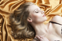 Portrait Of Blond Woman Laying, She Looks In To Th Royalty Free Stock Photography
