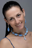 Portrait Of Cheerful Girl With Earrings And Necklace Royalty Free Stock Photo