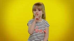 Free Portrait Of Child Girl Presses Index Finger To Lips Makes Silence Gesture Sign Do Not Tells Secret Royalty Free Stock Images - 217383539