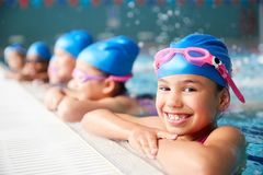Free Portrait Of Children In Water At Edge Of Pool Waiting For Swimming Lesson Royalty Free Stock Photography - 157272537