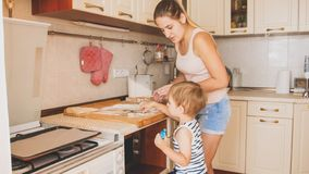 Free Portrait Of Cute 3 Years Old Toddler Boy Cooking Cookies With Mother. Family Cooking And Baking Royalty Free Stock Photo - 148363835