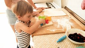 Free Portrait Of Cute 3 Years Old Toddler Boy Cooking Cookies With Mother. Family Cooking And Baking Stock Image - 148364691