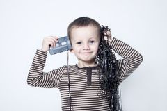 Portrait Of Cute Boy Playing With Old Tape Stock Image