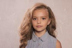 Free Portrait Of Cute Little 8-9 Year Old Girl With Blonde Hair, Wearing Jeans Jacket Stock Photos - 124922173