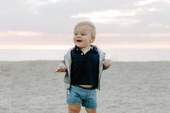 Free Portrait Of Cute Little Baby Boy Child Playing And Exploring In The Sand At The Beach During Sunset Outside On Vacation In Hoodie Royalty Free Stock Images - 142720029