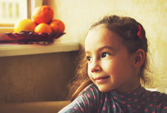 Portrait Of Cute Little Girl Dreaming. Toned Royalty Free Stock Image