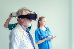Free Portrait Of Doctor Team Are Using Virtual Reality Technology To Royalty Free Stock Photos - 118668748