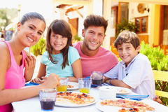 Portrait Of Family Eating Meal At Outdoor Restaurant Royalty Free Stock Photo