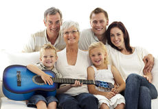 Portrait Of Family Playing Guitar At Home Royalty Free Stock Images