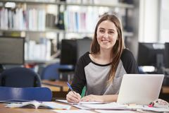 Free Portrait Of Female Student Working At Laptop In College Library Royalty Free Stock Photos - 104866298
