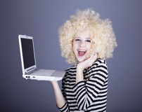 Portrait Of Funny Girl In Blonde Wig With Laptop. Stock Images