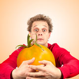 Portrait Of Funny Man With Tomato Stock Images