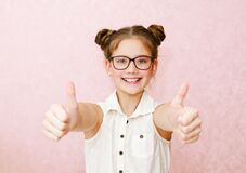 Free Portrait Of Funny Smiling Little Girl Child Wearing Glasses With Two Fingers Up Isolated Stock Image - 174433151