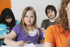 Free Portrait Of Girl (10-12) With Down Syndrome In Classroom Royalty Free Stock Images - 191844829