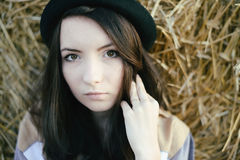 Portrait Of Girl Hipster Against Hay Bale In Fall Royalty Free Stock Photo