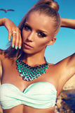 Portrait Of Girl With Blond Hair And Bright Makeup In Bikini Royalty Free Stock Photography