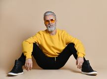Free Portrait Of Gray Hair Senior Millionaire Man In Yellow Sunglasses Pointing Fingers Up Stock Images - 135831794