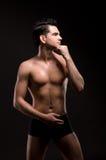 Portrait Of Half-naked Man On A Black Stock Photos