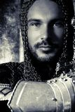 Portrait Of Handsome Medieval Knight In Suit Of Armour With Beard And Blue Eyes Looking At Camera Stock Photo