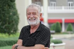 Free Portrait Of Happy Caucasian Senior Kind Man With Winkles And White Beard Mustache Hairs. Old Man Is Smiling Stock Image - 218858621