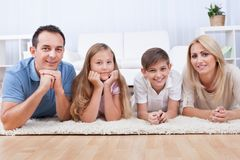 Free Portrait Of Happy Laying On Carpet Royalty Free Stock Photos - 27695908