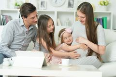 Portrait Of Happy Pregnant Woman With Husband And Daughters Stock Photography