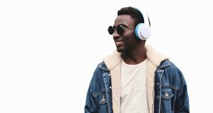 Free Portrait Of Happy Smiling African Man In Wireless Headphones Listening To Music Isolated On A White Background Stock Photos - 214580863
