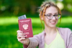 Free Portrait Of Happy Tourist Woman With Dreadlocks Holding Passport And Coffee On Holiday Stock Images - 148834254