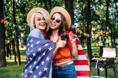 Free Portrait Of Happy Women In Hats And Sunglasses With American Flag Stock Images - 129001274