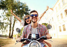 Free Portrait Of Happy Young Couple On Scooter Enjoying Road Trip Royalty Free Stock Image - 66709736