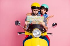 Free Portrait Of His He Her She Nice Attractive Worried Nervous Couple Driving Moped Lost On City Searching Address On Paper Stock Image - 180110931