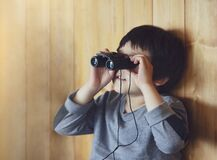 Free Portrait Of Kid Boy Child Looking Through Of Binoculars In The Animals Station View Point, A Young Explorer With Wildlife Nature Royalty Free Stock Photo - 184646645