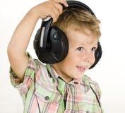 Portrait Of Little Cute Boy In Earphones Stock Photo