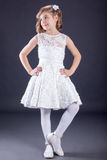 Portrait Of Little Girl In Luxurious Dress. Fashion Photo Stock Photo