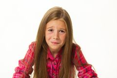 Portrait Of Little Girl Sitting Sad And Crying Over White Background Stock Photos