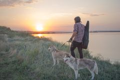 Free Portrait Of Male Traveler Walk With Dog On The Cliff Stock Photography - 130061822