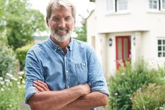Free Portrait Of Mature Man Standing In Garden In Front Of Dream Home In Countryside Royalty Free Stock Images - 159043209