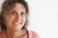 Free Portrait Of Mature Woman Standing Against Wall Royalty Free Stock Photo - 55902575