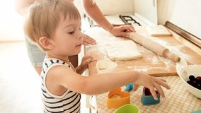 Free Portrait Of Mother With 3 Years Toddler Son Baking Cookies On Kitchen At Morning. Family Baking And Cooking At Home Stock Images - 148364324