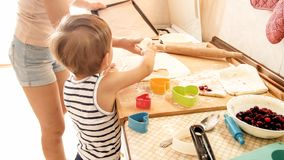 Free Portrait Of Mother With 3 Years Toddler Son Baking Cookies On Kitchen At Morning. Family Baking And Cooking At Home Royalty Free Stock Image - 148365296