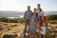 Free Portrait Of Multi Generation Family Standing At Top Of Hill On Hike Through Countryside In Lake District UK Royalty Free Stock Photo - 134204295