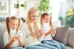 Free Portrait Of Nice Adorable Cute Attractive Lovely Lovable Winsome Charming People Mom Girls Sitting On Divan Using Device Royalty Free Stock Photography - 139274217